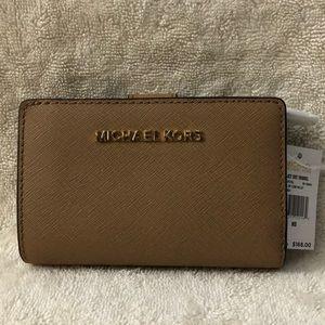 Michael Kors small brown bifold wallet
